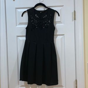 Black fit and flare dress with cut outs